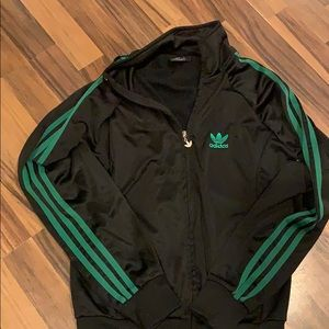 Black adidas jacket with green stripes